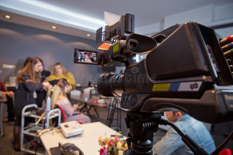 Makeup cosmetic at home. Focus on tripod mounted Video camera screen showing . In front of the camera to recording vlog video live. In front of the camera to stock image