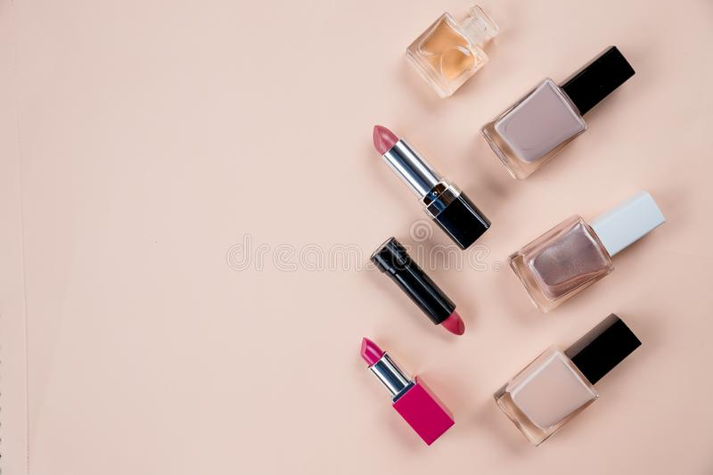 Makeup cosmetic products color background flat lay top view.woman beauty fashion decorative.Many cosmetics objects for royalty free stock photography