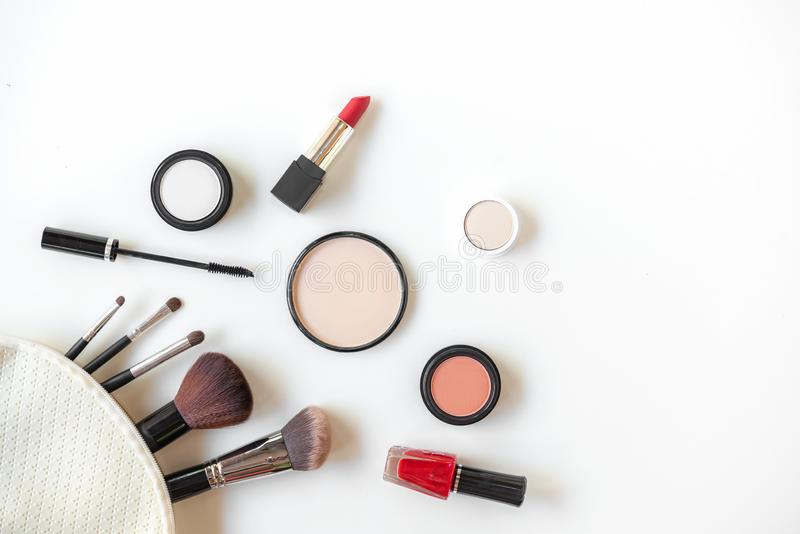 Makeup cosmetics tools background and beauty cosmetics, products and facial cosmetics package lipstick, eye shadow on the white ba stock photography
