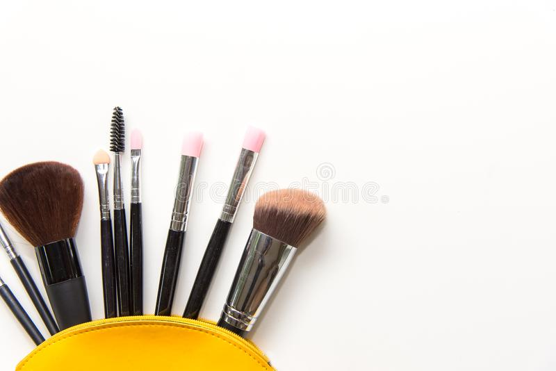 Makeup cosmetics tools background and beauty cosmetics, products and facial cosmetics package lipstick, eyeshadow on the white bac royalty free stock photos
