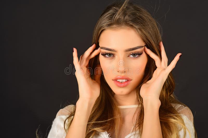 Makeup, cosmetics and visage. Skincare, beauty and fashion, look. pretty young woman with fashionable makeup on strait eyes, copy space royalty free stock photography