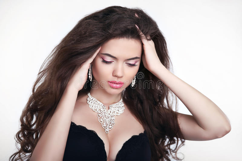 Makeup. Diamond jewelry. Beautiful woman in expensive pendant cl royalty free stock image