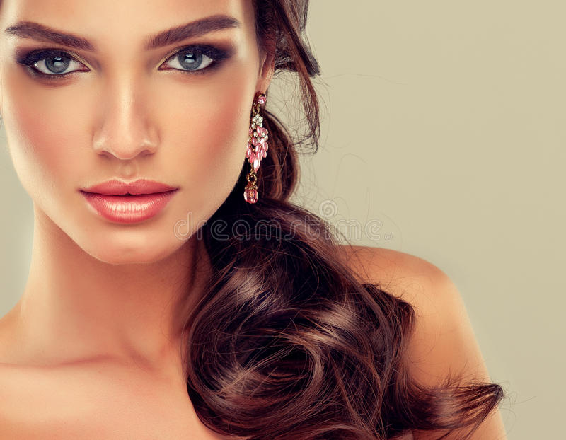 Makeup for eyes and lips ,eyeliner and coral lipstick. royalty free stock photos