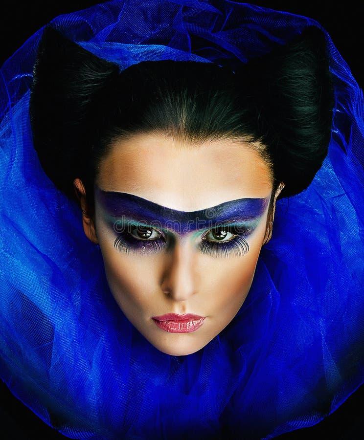 makeup för flicka för blå krage lyxig wide fotografering för bildbyråer