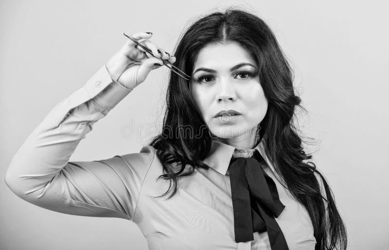 Makeup false lashes volume. Eyelash extension tweezer. Girl makeup face hold tweezer for eyelash extension. Professional royalty free stock image