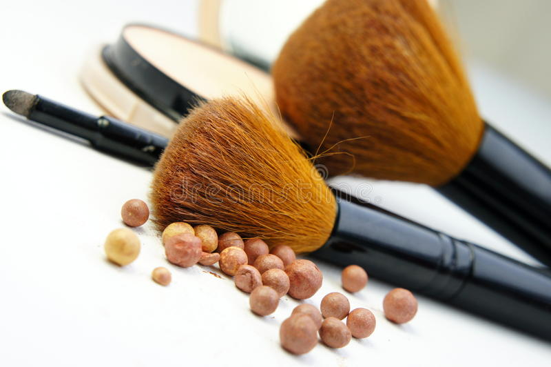 Makeup foundation, powder, bronzer and brushes. Makeup room: makeup foundation, powder, bronzer and brushes stock photo