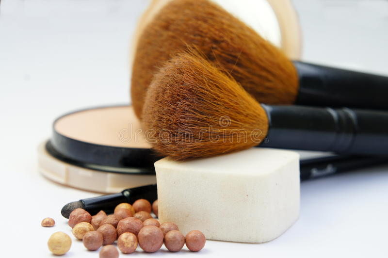 Makeup foundation, powder, bronzer and brushes. Makeup room: makeup foundation, powder, bronzer and brushes royalty free stock photos
