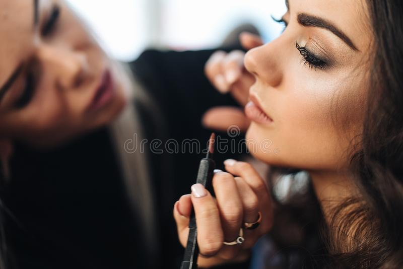 Makeup and hairstyle for a beautiful model royalty free stock photography