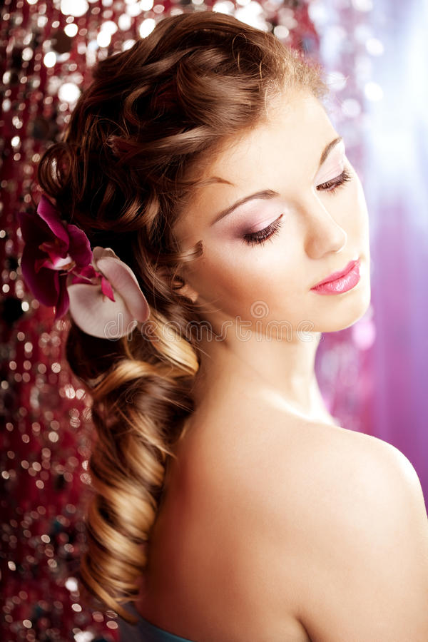 Makeup, hairstyle. Young beautiful woman with luxurious hair. Mo royalty free stock photography