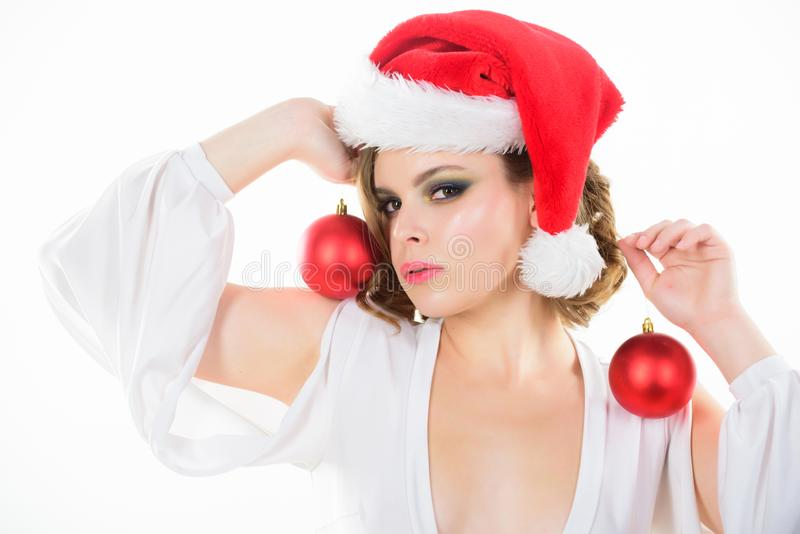 Makeup idea for corporate party. Girl with makeup and hairstyle ready to celebrate. Makeup and outfit for christmas. Party. Woman hold decorative balls on white royalty free stock images