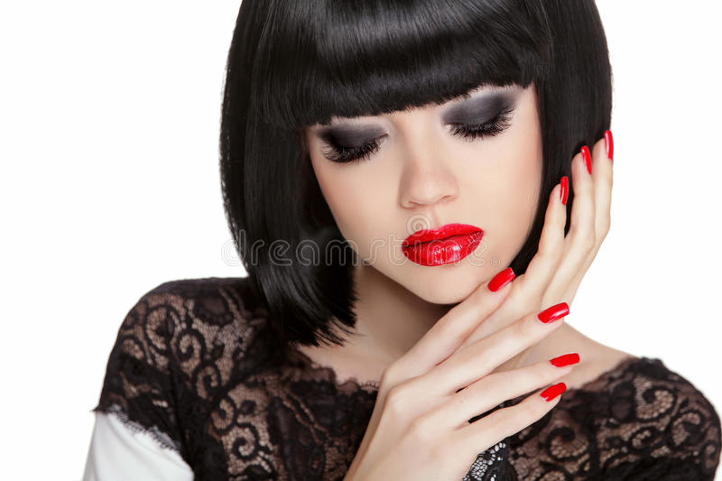 Makeup. Manicured nails. Black bob short hair styling. Brunette. Young woman portrait isolated on white background stock photo