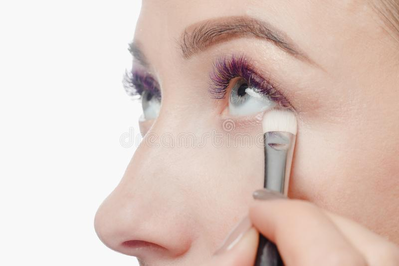 Makeup model process. Permanent makeup eyebrows for young woman in beauty salon, process of applying pigment stock photography