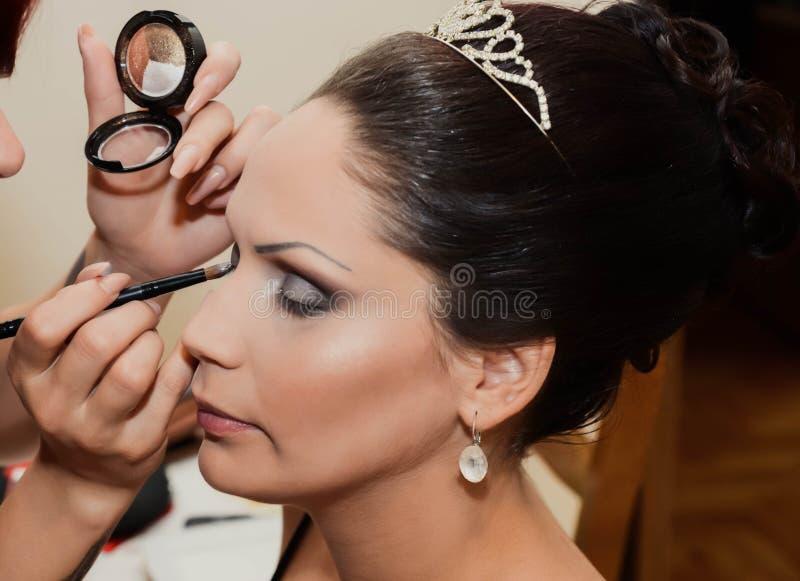 Makeup på brud close upp royaltyfria foton
