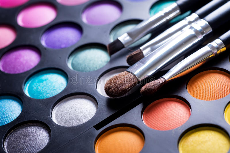Makeup palette. Makeup brushes and make-up eye shadows close-up.Selective focus