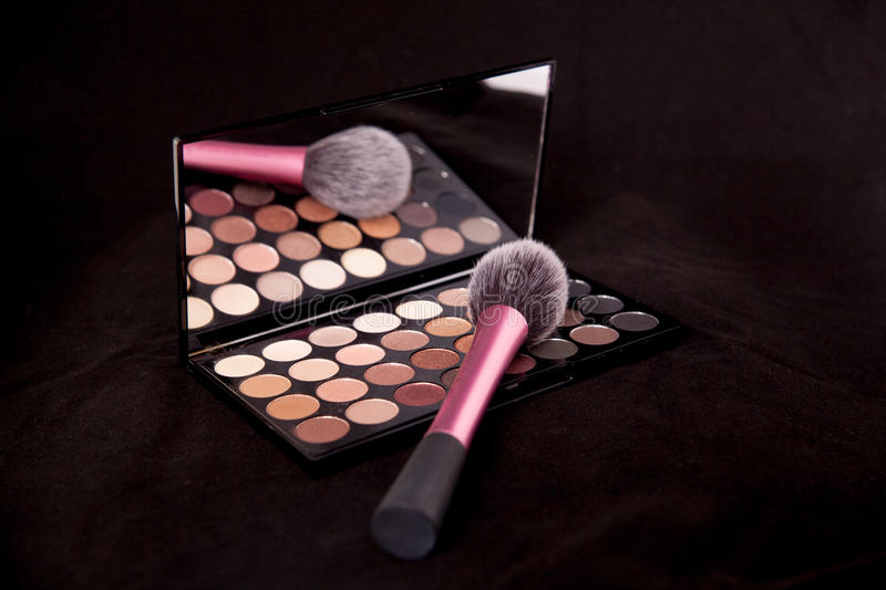 Download Makeup Palette And Brush On Pure Black Background. Makeup Colors For The New Year. Stock Photo - Image: 83722608