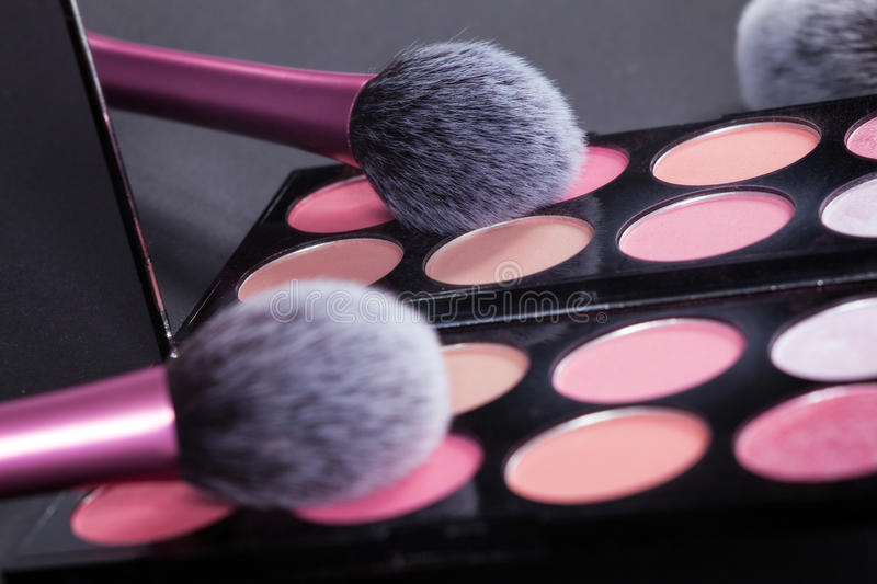 Download Makeup Palette And Brush Reflect In Mirror. Stock Photo - Image: 83722579