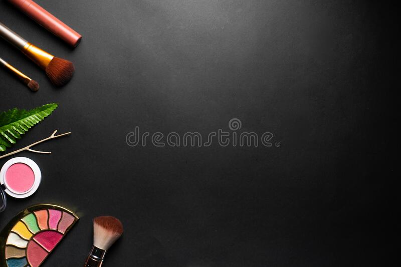 Makeup palette and brushes isolated in black background with copy space stock photography
