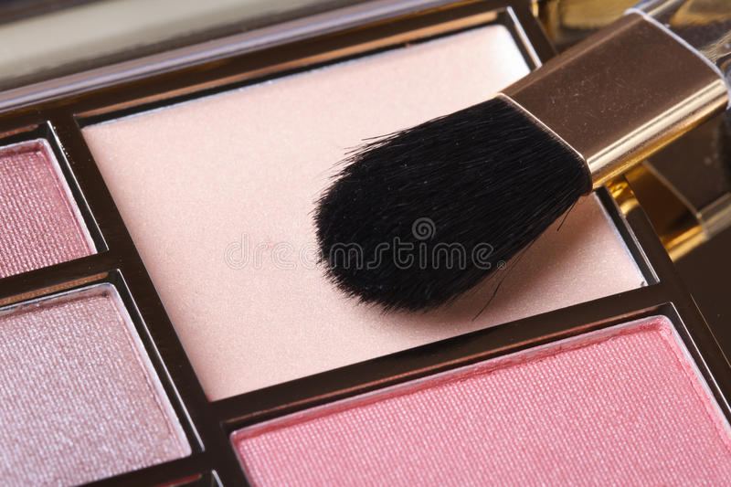 Makeup palette in pink tones with an applicator. blush. Close up macro royalty free stock images