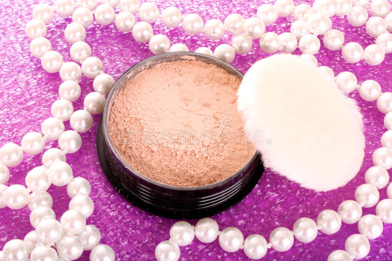 Makeup powder. On pink background stock photo