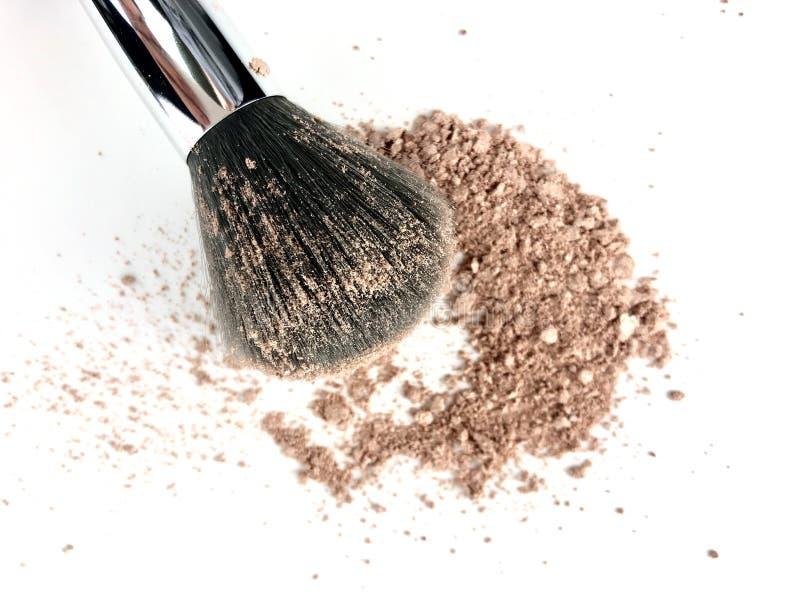 Makeup powder and brush stock photos