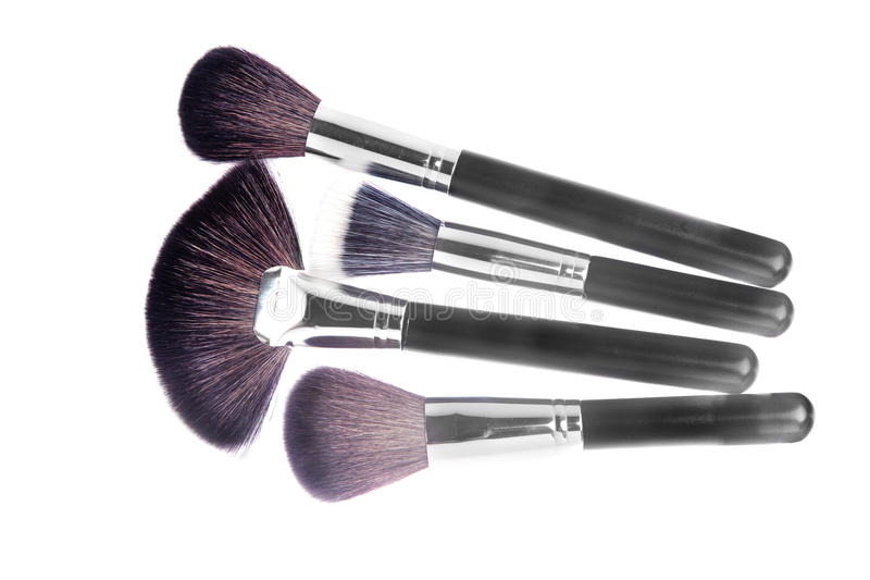 Makeup powder brushes. Different types of makeup powder and foundation brushes isolated on white stock photography