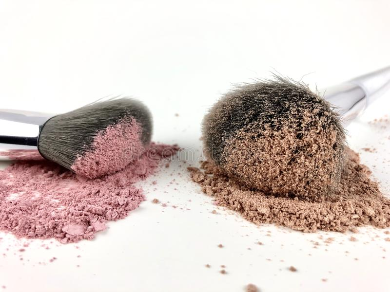Makeup powder and brushes royalty free stock photography