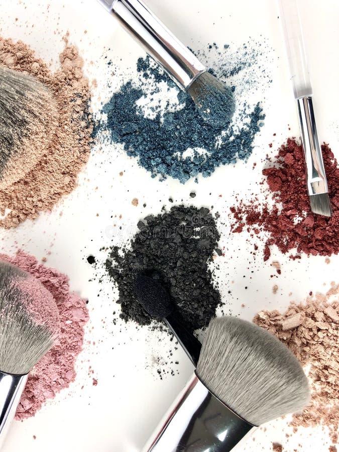 Makeup powder and brushes stock photo