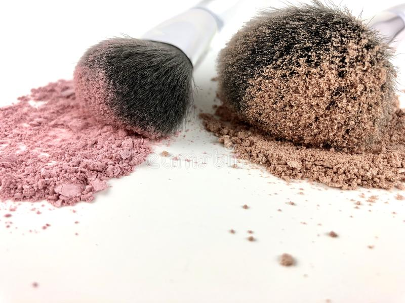 Makeup powder and brushes royalty free stock images