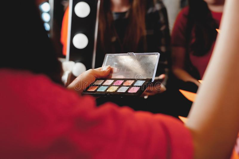 Makeup. The process of applying makeup will begin. Colorful palette. Cosmetics for festive evening day make up. Makeup. The process of applying makeup will begin stock photo