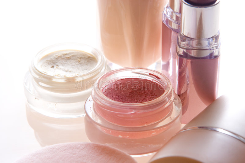 Makeup products. Foundation, lipstick, eyeshadow, blusher and applicator stock photography
