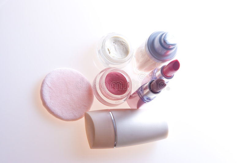 Makeup products. Foundation, lipstick, eyeshadow, blusher and applicator royalty free stock photos