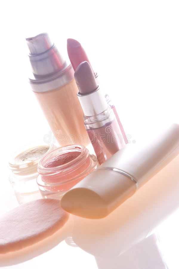 Makeup products. Foundation, lipstick, eyeshadow, blusher and applicator stock image