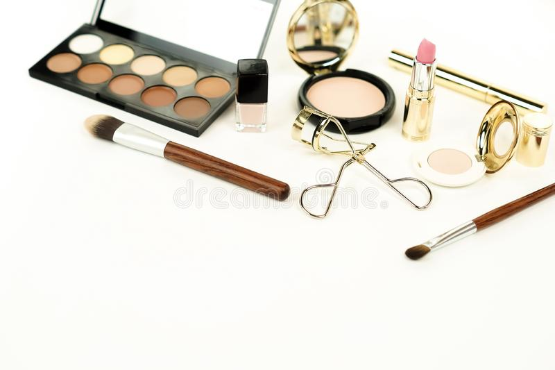 Makeup products and accessories on white background. female fashion desk. stock photos