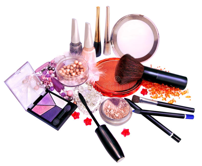 Makeup products and jewelry on white background royalty free stock photo