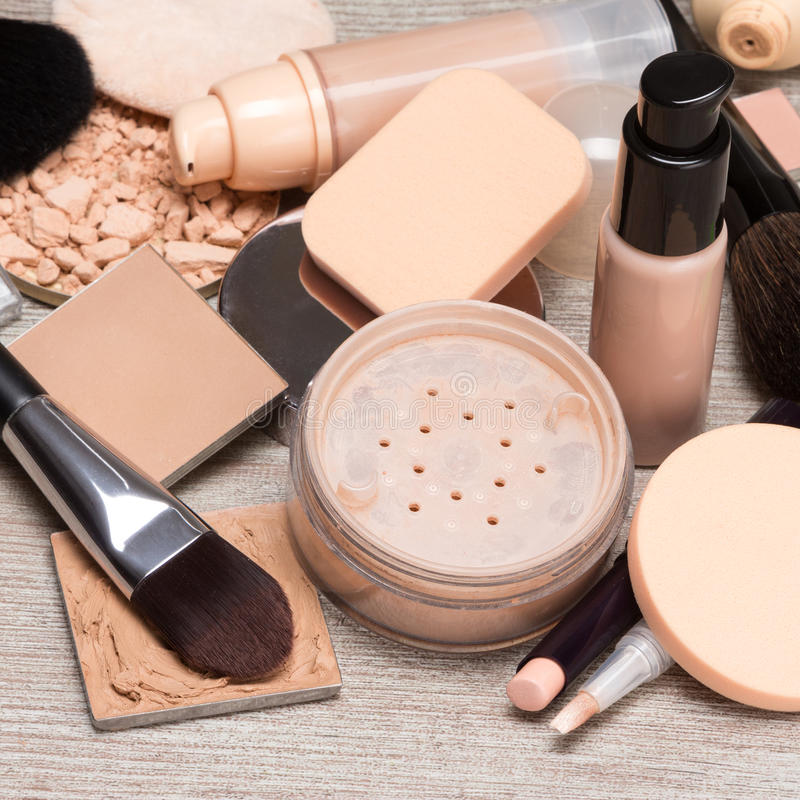 Makeup products to even out skin tone and complexion. Makeup products and accessories to even out skin tone and complexion. Concealers, bottles of liquid royalty free stock photos