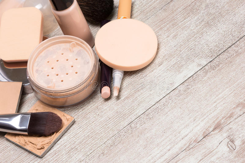 Makeup products to even out skin tone and complexion background. Beauty theme background. Various makeup products and accessories to even out skin tone and royalty free stock images