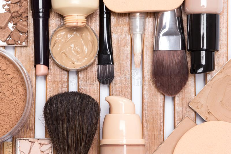 Makeup products to even out skin tone and complexion. Concealer, primer, foundation, cosmetic powder, make up brushes and sponges. Makeup products to even out royalty free stock images