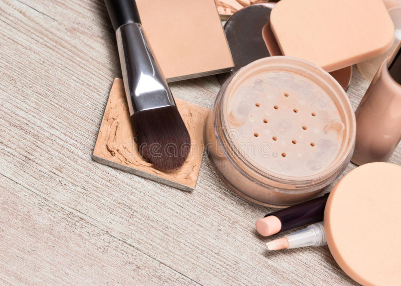Makeup products to even out skin tone and complexion. Various makeup products and accessories to even out skin tone and complexion. Concealers, foundation royalty free stock image