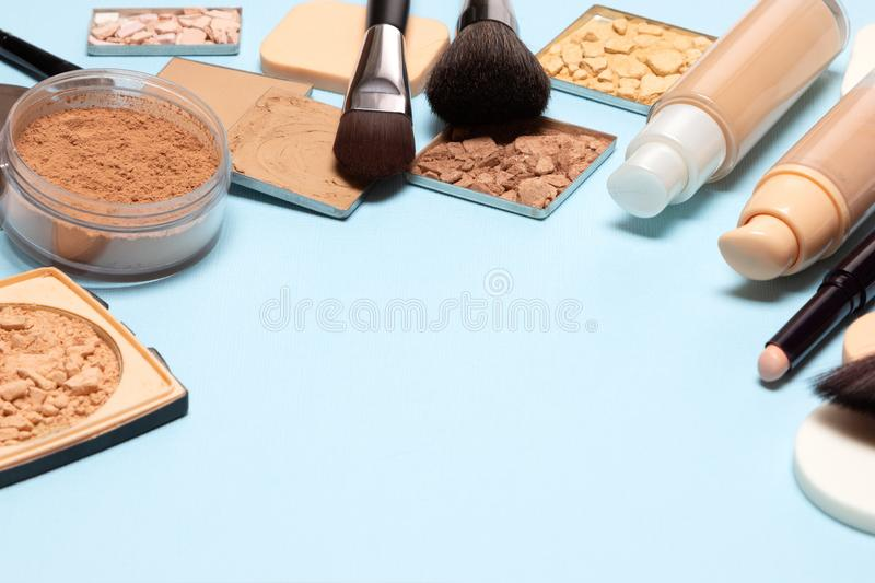Makeup products to even skin tone and complexion with copy space. Primer, concealer, foundation, powder, highlighter, bronzer. Make-up cosmetics background stock photos