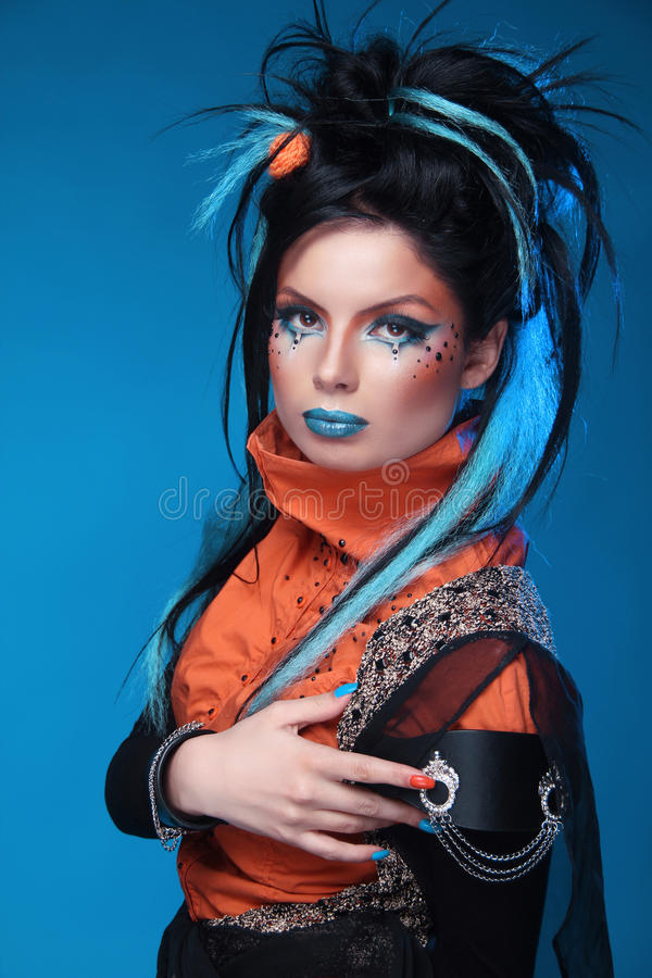 Makeup. Punk Hairstyle. Close up portrait of Rock girl with Blue royalty free stock photos