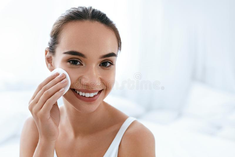 Makeup Remove. Girl Cleaning Face Skin With Cosmetic Pad stock photo