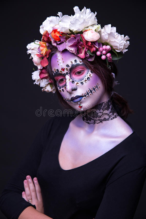 Makeup with Rhinestones and Wreath of Flowers Halloween theme royalty free stock photo