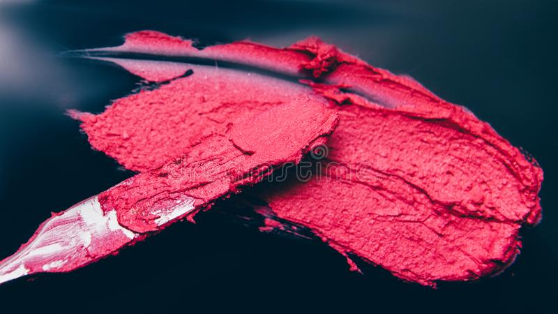 Makeup school artistry business lipstick smear. Makeup school. Artistry business. Crimson red lipstick smear made with spatula royalty free stock photography