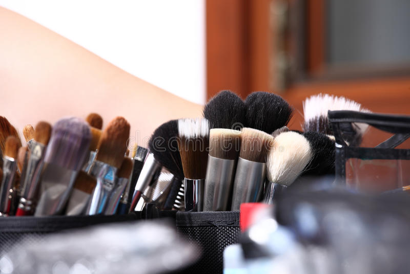 Makeup various colored brushes, closeup stock photo