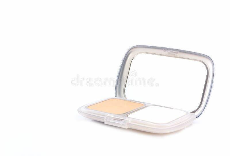Makeuppulver i det vita fallet royaltyfri foto