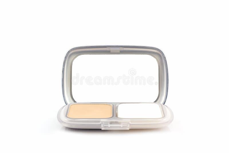 Makeuppulver i det vita fallet royaltyfria foton