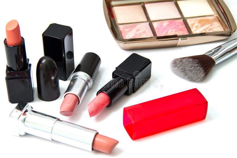 Makeuprodnad och läppstift royaltyfria foton