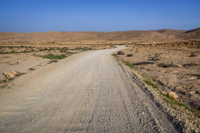 Makhtesh (crater) Ramon, is a geological landform of a large erosion cirque in the Negev Desert, Southern Israel. Road in Makhtesh (crater) Ramon, is a stock photography