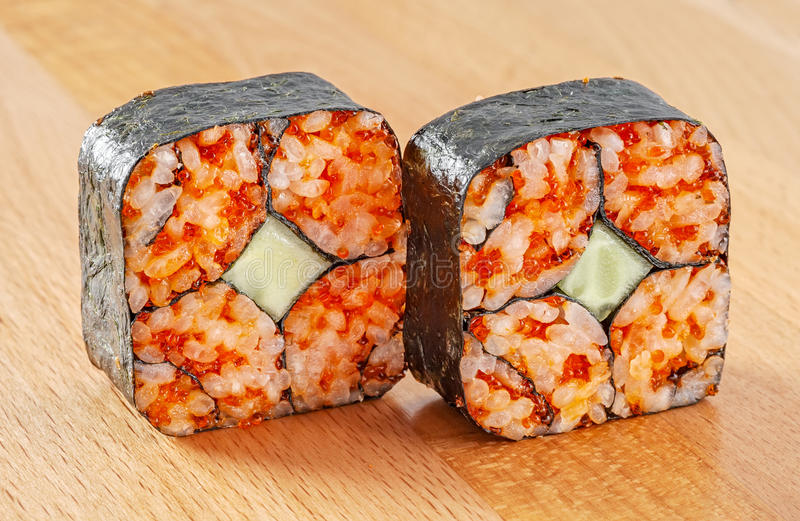 Maki Sushi Roll with Nori, Cucumber and Red Tobiko stock image