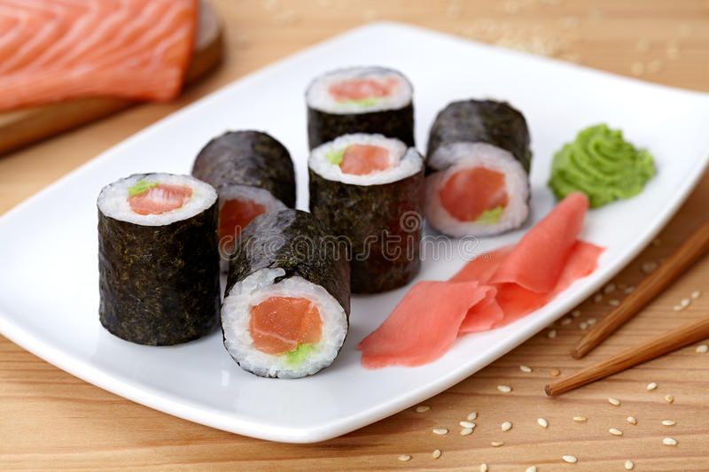 maki sushi roll with salmon wasabi ginger and stock photo image of roll asian 65468098. Black Bedroom Furniture Sets. Home Design Ideas